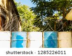 barbed wire on barrels  border | Shutterstock . vector #1285226011