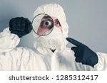 scientist in protective... | Shutterstock . vector #1285312417