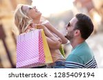 portrait of happy couple with...   Shutterstock . vector #1285409194