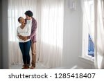 happy young man embracing his... | Shutterstock . vector #1285418407
