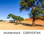 motorhome stands in the shade... | Shutterstock . vector #1285424764