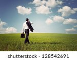 businessman in a suit with a... | Shutterstock . vector #128542691