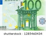 Obverse side of Euro Zone banknote of 100 Euros. Horizontal macro close-up view. - stock photo