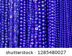blue beads background.... | Shutterstock . vector #1285480027