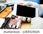 technicians to fix mobile phones | Shutterstock . vector #1285525024