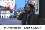 man takes a phone call at...   Shutterstock . vector #1285533004