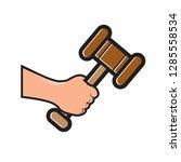 hand holding gavel hammer...   Shutterstock .eps vector #1285558534