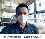 a man wearing mouth mask... | Shutterstock . vector #1285590274
