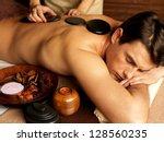 handsome man having stone... | Shutterstock . vector #128560235