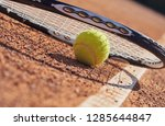 tennis balls and racket on the...   Shutterstock . vector #1285644847