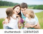 Happy Family With Flowers...