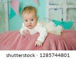 little newborn baby girl lying... | Shutterstock . vector #1285744801