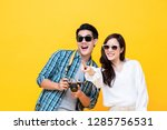 happy excited young asian... | Shutterstock . vector #1285756531