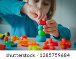 child playing with clay molding ... | Shutterstock . vector #1285759684
