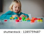 child playing with clay molding ... | Shutterstock . vector #1285759687