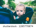 a child is sitting in a... | Shutterstock . vector #1285770874