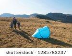 mother and children holding... | Shutterstock . vector #1285783237