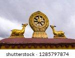 rooftop statues of two golden... | Shutterstock . vector #1285797874