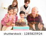 happy asian family celebrating... | Shutterstock . vector #1285825924