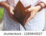 close up man person  holding an ... | Shutterstock . vector #1285843027