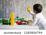 happy baby playing with toy... | Shutterstock . vector #1285856794