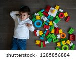 happy baby playing with toy... | Shutterstock . vector #1285856884