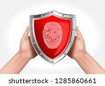 hands holding a shield...   Shutterstock .eps vector #1285860661