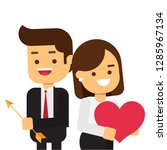 happy couple holding arrow and...   Shutterstock .eps vector #1285967134