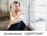 model blonde white shirt blue... | Shutterstock . vector #1285972447