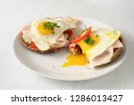 fried egg with running yolk on... | Shutterstock . vector #1286013427
