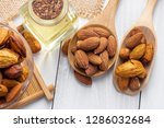 almonds in a black bowl against ... | Shutterstock . vector #1286032684