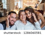 a young couple with grandmother ...   Shutterstock . vector #1286060581