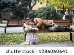 Homeless Beggar Man With A Bag...