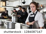 tired and upset waitress in... | Shutterstock . vector #1286087167