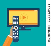 hand holding remote control. tv ...   Shutterstock .eps vector #1286129311