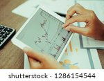 closeup of trader working with... | Shutterstock . vector #1286154544