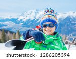 portrait of cute happy skier... | Shutterstock . vector #1286205394