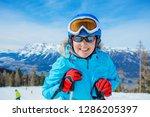 portrait of happy skier woman...   Shutterstock . vector #1286205397