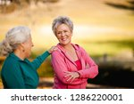 two smiling senior woman... | Shutterstock . vector #1286220001