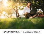 woman sitting on grass at park... | Shutterstock . vector #1286304514