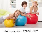 People exercising with large rubber balls - health education in children - stock photo