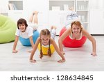 Happy people using large exercise balls - doing gymnastic at home - stock photo
