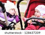 two baby girls sitting in... | Shutterstock . vector #128637209