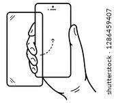 hand holding smartphone....   Shutterstock .eps vector #1286459407