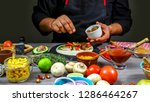 chef cooking mexican taco. cook ...   Shutterstock . vector #1286464267