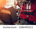 fireman extinguishes the fire...   Shutterstock . vector #1286490211