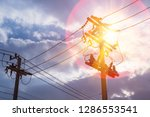 high voltage pole and sunshine. ... | Shutterstock . vector #1286553541