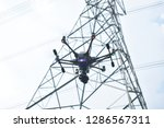 drones fly in the air check the ... | Shutterstock . vector #1286567311