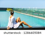 young woman relaxing by the... | Shutterstock . vector #1286605084