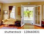 living room with open doors to... | Shutterstock . vector #128660831
